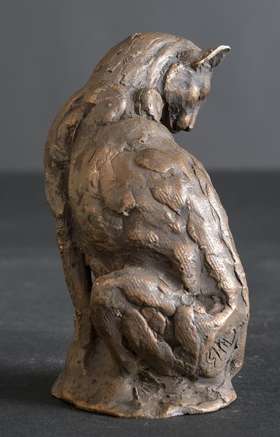 Cleaning Cat bronze sculpture