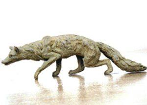 fox stalking bronze statue