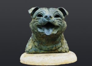 Bronze statue of a dogs head